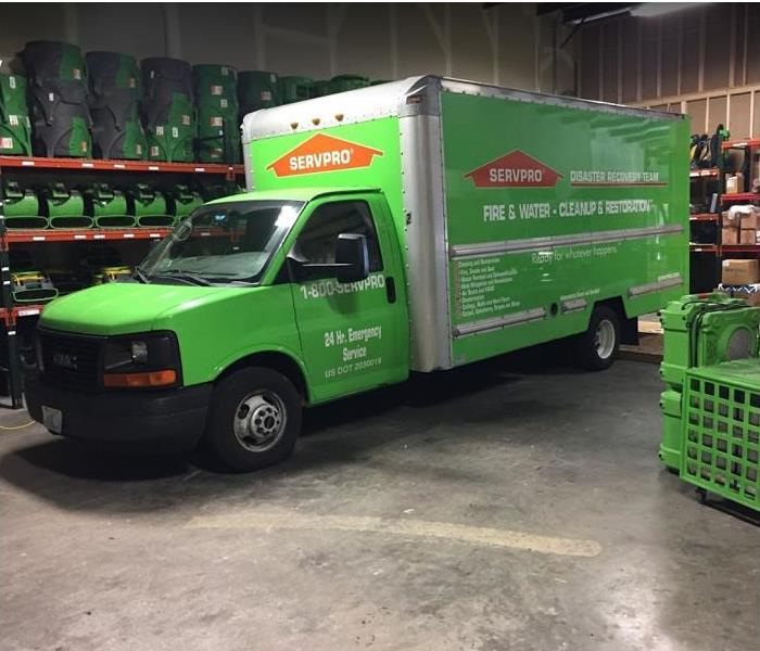 SERVPRO vehicle and restoration equipment inside SERVPRO storage facility